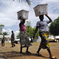 Citizens and UNMIL destroy voting materials in Liberia.